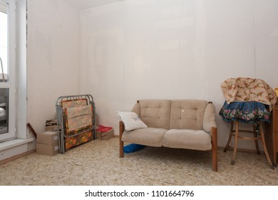 MOSCOW, RUSSIA - CIRCA MAY, 2018: A room in a two-room apartment. Wallpapers. Linoleum floor. Interior items, sofa.