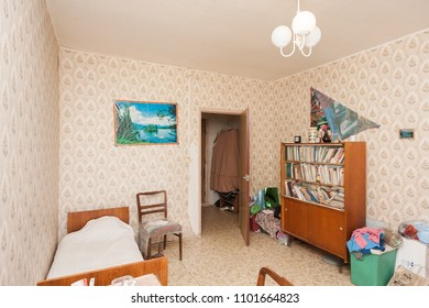 MOSCOW, RUSSIA - CIRCA MAY, 2018: A room in a two-room apartment. Wallpapers. Linoleum floor. Interior items, furniture. Door to corridor.