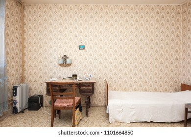 MOSCOW, RUSSIA - CIRCA MAY, 2018: A room in a two-room apartment. Wallpapers. Linoleum floor. Interior items, table, chair, bed.