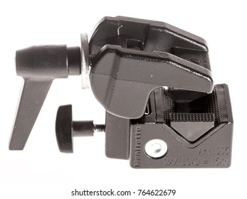 MOSCOW, RUSSIA - CIRCA NOVEMBER, 2017: Manfrotto super clamp 035 on white background. Triangular plastic detail of clamp allows secure clamping of flat structures.