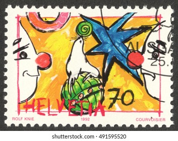 """MOSCOW, RUSSIA - CIRCA OCTOBER, 2016: a stamp printed in SWITZERLAND shows Sealion & Auguste, the series """"Circus"""", circa 1992"""