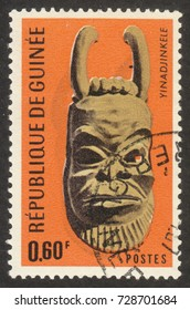 """MOSCOW RUSSIA - CIRCA OCTOBER 2017: a post stamp printed in GUINEA shows a traditional mask, the series """"The masks"""", circa 1967"""