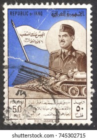 """MOSCOW, RUSSIA - CIRCA OCTOBER, 2017: a post stamp printed in IRAQ shows General Kassem and tank parade, the series """" The Army Day"""", circa 1963"""