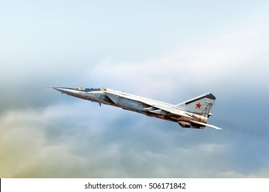 MOSCOW, RUSSIA - CIRCA SEPTEMBER, 2005: Russian air force Mig-25 foxbat supersonic military twin jet engine fighter interceptor aircraft warbird plane performing high speed pass aerial exterior view