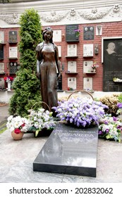 MOSCOW, RUSSIA - CIRCA SEPTEMBER, 2010: Last resting place of Raisa Gorbachev-Titarenko at the Novodevichy National cemetery in Moscow. Black tomb slab with bronze statue of a mourning young woman.