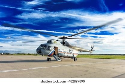 MOSCOW, RUSSIA - CIRCA SEPTEMBER, 2016: Russian Air Force Mil Mi-8 Hip military transport VIP executive helicopter aircraft landed exit door open dramatic sky detail exterior panoramic wide view