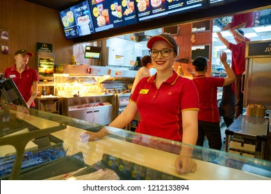 MOSCOW, RUSSIA - CIRCA SEPTEMBER, 2018: indoor portrait of young worker in McDonald's restaurant in Moscow.