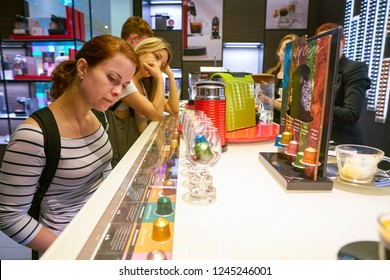 MOSCOW, RUSSIA - CIRCA SEPTEMBER, 2018: woman choose coffee at a Nespresso store in Moscow, Russia.