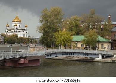 Moscow Russia City View on River, old buildings and Christ the Savior Cathedral on against dramatic cloudy sky.