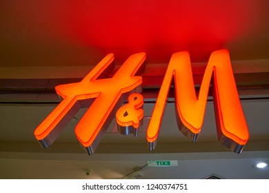 MOSCOW, RUSSIA - CRICA SEPTEMBER, 2018: H&M brand name over entrance to a store in shopping center in Moscow.