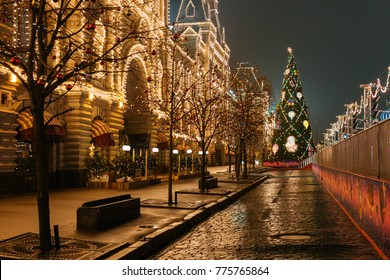 Moscow, Russia - Dec 13, 2017: New Year's decorations and preparations of the city center for the new year celebration: colorful neon lights, Christmas tree, skating rink on the red square at night.