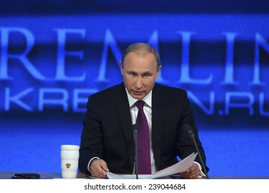MOSCOW, RUSSIA - DEC 18: The President of the Russian Federation Vladimir Vladimirovich Putin an annual press conference in Center of international trade in Moscow on 18 of December 2014, Russia