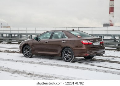 Moscow, Russia - December 03, 2017 Toyota Camry brown sedan parked on the snowy flyover