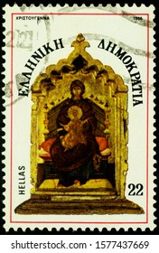Moscow, Russia - December 03, 2019: stamp printed in Greece, shows ancient icon Madonna and child enthroned, center panel of tryptich, circa 1986