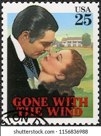 MOSCOW, RUSSIA - DECEMBER 08, 2016: A stamp printed in USA shows Gone with the wind, Vivien Leigh as Scarlett, Clark Gable  as Rhett, Classic Films, 1990