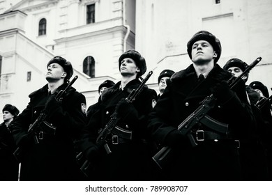 MOSCOW, RUSSIA - DECEMBER 09, 2017: Formation of the Presidential Regiment of the Service of Moscow Kremlin's Commandant. Winter view. Cathedral Square, Kremlin, Moscow. Black and white photo.