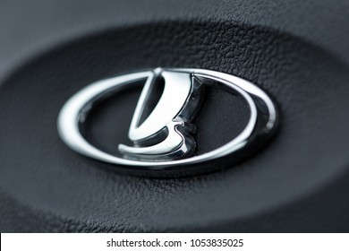 """Moscow, Russia - December 10, 2017: Logo of the car company """"LADA"""" on the steering wheel of the car, close-up"""
