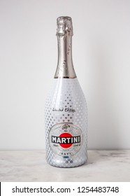 MOSCOW, RUSSIA - DECEMBER 10, 2018: Bottle of Quality Aromatic Sparkling Wine Martini Asti on White Wall Background. Product of Italy.