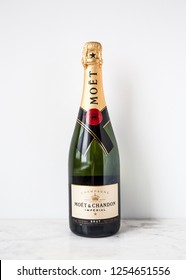 MOSCOW, RUSSIA - DECEMBER 10, 2018: Moët & Chandon Imperial Champagne Bottle on White Wall Background. Product of France.