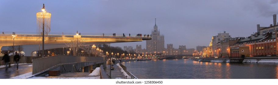 Moscow, Russia, December 11, 2018. People on the bridge over the Moscow River in Zaryadye Park. Panorama of Moscow, cityscape