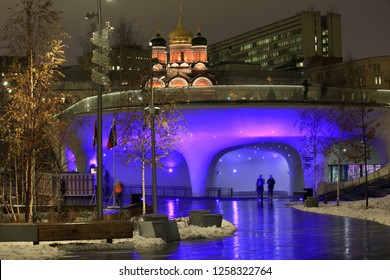 "Moscow, Russia, December 11, 2018. Ice cave in the park ""Zaryadye"". Beautiful view of the night city"