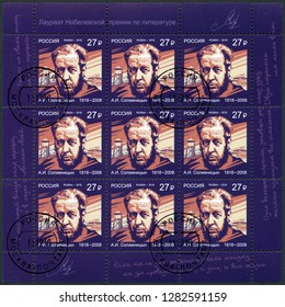 MOSCOW, RUSSIA - DECEMBER 11, 2018: A stamp printed in Russia shows Aleksandr Solzhenitsyn (1918-2008), novelist, series Nobel Laureate in Literature, 2018