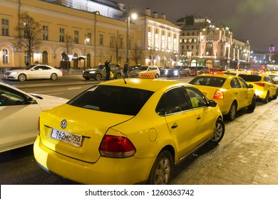 Moscow. Russia. December 12, 2018. Taxi near the building of the Bolshoi theatre