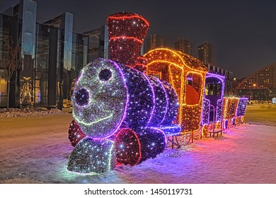 "MOSCOW, RUSSIA - December 12, 2018 New Year LED installation of funny train, the little hero of popular Soviet animation movie ""Train from Romashkovo"" (1967) in park Khodynskoye Pole (Khodynka Field)."