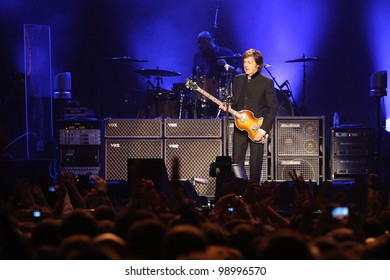MOSCOW, RUSSIA - DECEMBER 14: Ex-beatle Sir Paul McCartney performs onstage at Olimpiyskiy Arena December 14, 2011 in Moscow, Russia.