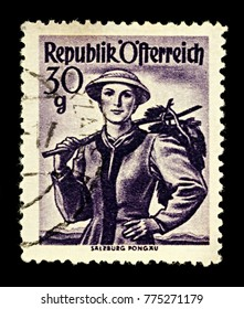 """Moscow, Russia - December 15, 2017: A stamp printed in Austria, shows woman in national Austrian costume, Salzburg, Pongau, series """"Provincial Costumes"""", circa 1950"""