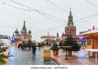 MOSCOW, RUSSIA - DECEMBER 17, 2013: Christmas fair in the middle of the Red Square in Moscow, Russia in Dec.17, 2013. These fairs originated in Germany, Austria, South Tyrol, North Italy