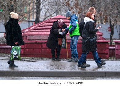 Moscow, Russia - December, 17, 2017: begger stands on Moscow street