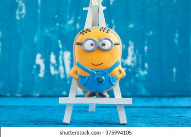 "MOSCOW, RUSSIA - DECEMBER 18, 2015: Homemade gingerbread cookie in the shape of Minion. Minion is a character of the animated film ""Despicable Me"", 2010. Photo editorial."