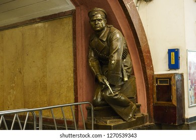 Moscow / Russia - December 18 2018: Moscow metro station interior. Statue of of a red guarder with revolver in the Ploshchad Revolyutsii/Revolution square metro station