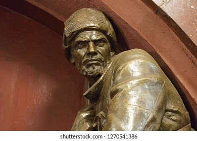 Moscow / Russia - December 18 2018: Moscow metro station interior. Statue of a red guarder in the Ploshchad Revolyutsii/Revolution square metro station