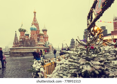 MOSCOW, RUSSIA - DECEMBER 19 , 2017: Moscow residents and tourists walk on red square near Gum skating rink and after a snowfall in Moscow