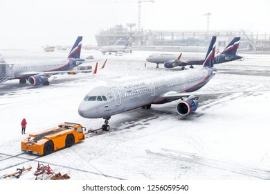 Moscow, Russia - December 2, 2018: Aeroflot Russian Airlines Airbus A321 taxiing in the Sheremetyevo International Airport during a heavy snowfall.