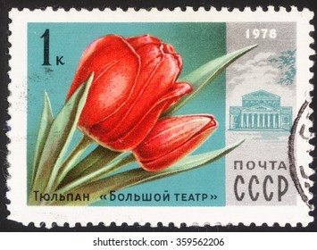 """MOSCOW, RUSSIA - DECEMBER, 2015: a post stamp printed in the USSR shows Bolshoi Theatre and a red tulips, the series """"Moscow Flowers & Buildings"""", circa 1978"""