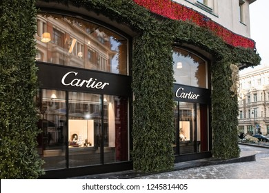 Moscow, Russia - December, 2018: Fashion Week Cartier shopping. Christmas Eve Holiday Decoration, Cartier Porters With Gifts And Presents. New Year Celebration in Luxury store Cartier in Moscow.