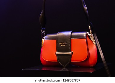 Moscow, Russia - December, 2018: Fashion Week Prada shopping. New Handbag collection - Prada Sidonie Belt Bag in Red With Buckled Flap Closure, Prada Resort 19. Luxury store Prada in Moscow.