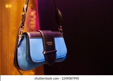Moscow, Russia - December, 2018: Fashion Week Prada shopping. New Handbag collection - Prada Sidonie Belt Bag in Blue With Buckled Flap Closure, Prada Resort 19. Luxury store Prada in Moscow.