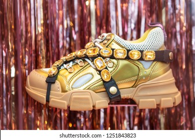 Moscow, Russia - December, 2018: Fashion Week Gucci shopping. Collection FW 2018 - SS 2019. Gucci Flashtrek Sneakers Decorated With Removable Elastic Straps Adorned By Crystals. Gucci store in Moscow.