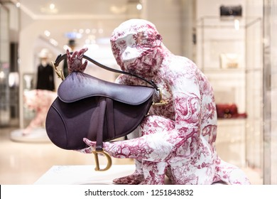 Moscow, Russia - December, 2018: Fashion Week Dior shopping. Saddle Bag In Lilac Leather. Luxury store Dior in Moscow.