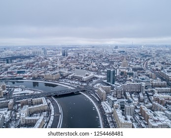 Moscow Russia December 2018. Government House of the Russian Federation. View from above. Shot taken with quadcopter in winter. Downtown rooftops and bridges on the Mosckva river.