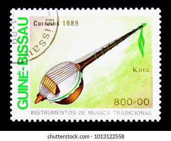 MOSCOW, RUSSIA - DECEMBER 21, 2017: A stamp printed in Guinea-Bissau shows Kora, Traditional Music Instruments serie, circa 1980
