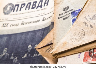 Moscow, RUSSIA - December 23, 2017: A stack of postal letters of WW2 on the newspaper Pravda
