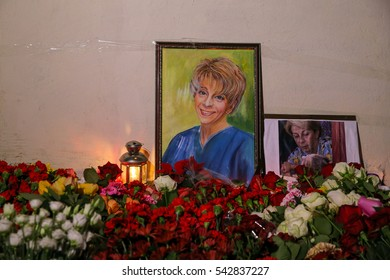 MOSCOW, RUSSIA - DECEMBER 25, 2016: Portret and flowers in memory of the victims plane crash near office of Spravedlivaya Pomoshch Fund [Just Aid Foundation] headed by Yelizaveta Glinka (Doctor Liza).