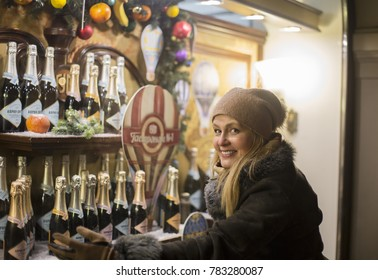 Moscow, Russia - December 25, 2017: State Universal Shop. Pretty woman near showcase with bottles of shampagne