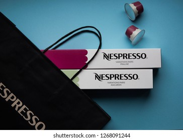 MOSCOW, RUSSIA - DECEMBER 26, 2018: Limited Collection Nespresso Variations Paris Coffee Capsules on Blue Background. Coffee Blend Praline and Macaron. Nespresso is Worldwide Company of Coffee Product