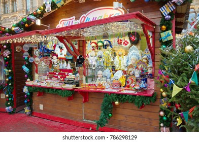 Moscow, Russia - December 28, 2017: Christmas and New year's fair on Red square. Trade stall with Russian national costumes and Souvenirs.